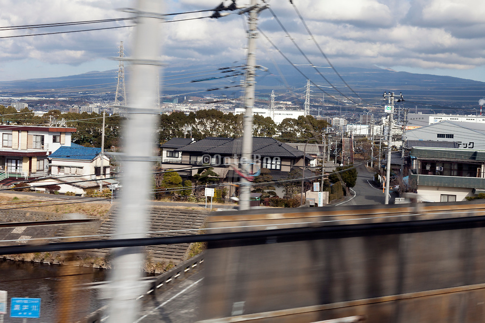 view from the Shinkansen train with in the background  mounth Fuji in the clouds Tokai area