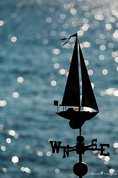 North America, United States, Washington, Kirkland, sailboat weathervane and sparkling lake