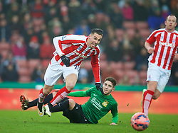 STOKE-ON-TRENT, ENGLAND - Sunday, January 4, 2015: Wrexham's Rob Evans tackles Stoke City's Geoff Cameron during the FA Cup 3rd Round match at the Britannia Stadium. (Pic by David Rawcliffe/Propaganda)