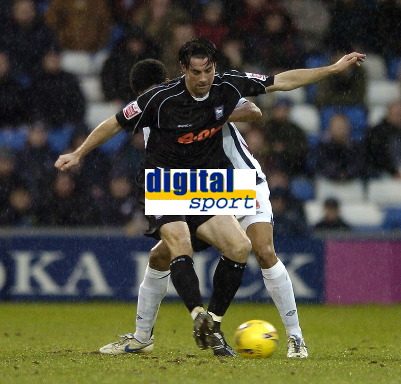Photo: Jonathan Butler.<br />West Bromwich Albion v Ipswich Town. Coca Cola Championship. 30/12/2006.<br />Alan Lee of Ipswich holds off Curtis Davies of West Bromwich.