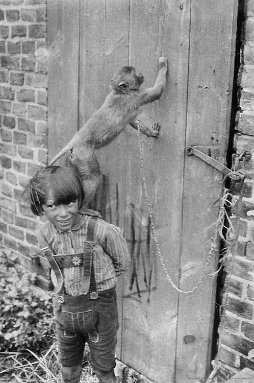 Monky and boy, location unknown,1937