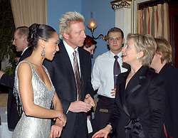 Former German tennis champion Boris Becker and his girlfriend, French dancer Caroline Rocher (L), congratulate U.S. Senator Hillary Rodham Clinton who was awarded the 2004 German Media Prize 'Deutscher Medienpreis' in Baden-Baden, Germany, on February 13, 2005. Photo by Media Control-Balkis Press/ABACA.