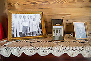 Family photos sit on the original Cash family piano in the living room of the boyhood home of musician Johnny Cash on Saturday, August 16, 2014, in Dyess, Ark. The home was restored to it's appearance when the Cash family lived in it, from 1935-1954, and was part of The Dyess Colony that was created in 1934 as part of President Franklin D. Roosevelt's New Deal.<br /> <br /> Photo by Beth Hall