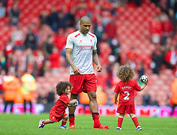 LIVERPOOL, ENGLAND - Sunday, May 11, 2014: Liverpool's Glen Johnson with his sons on the pitch after the Premiership match at Anfield. (Pic by David Rawcliffe/Propaganda)