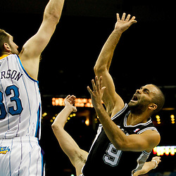 Jan 7, 2013; New Orleans, LA, USA; San Antonio Spurs point guard Tony Parker (9) shoots over New Orleans Hornets power forward Ryan Anderson (33) during the second quarter of a game at the New Orleans Arena. Mandatory Credit: Derick E. Hingle-USA TODAY Sports