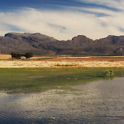 Mountains, fields and pond outside Ceres, Western Cape, South Africa