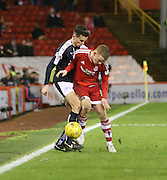 Dundee&rsquo;s Paul McGinn and Aberdeen&rsquo;s Jonathan Hayes tussle for the ball - Aberdeen v Dundee, Ladbrokes Premiership at Pittodrie<br /> <br />  - &copy; David Young - www.davidyoungphoto.co.uk - email: davidyoungphoto@gmail.com