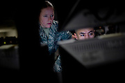 Imagery analysts Senior Airman Alanna Cherry, left, and Airman First Class Andres Morales, right, monitor classified imagery in the intelligence operations center at Beale Air Force Base February 23, 2010 in Linda, Calif.