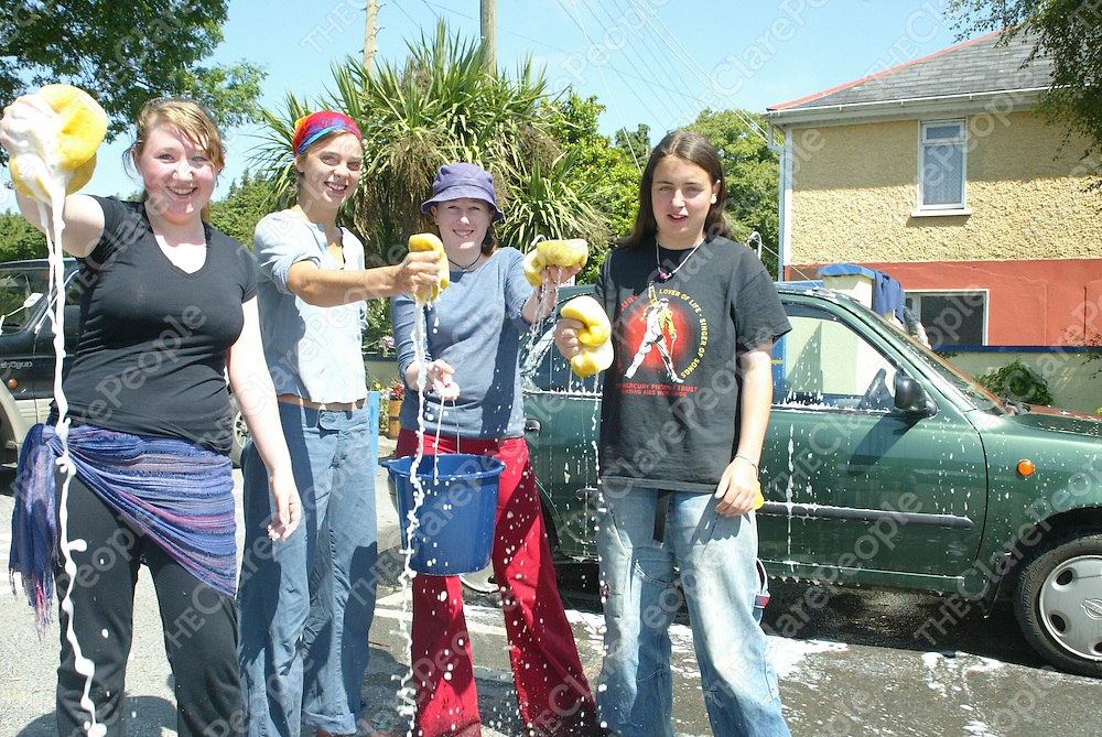 Rebecca Milne, Sophie Breuker, Romy Rae and Naoise Lammers who did a fundraising Car Wash at the GALA Superstore in Tuamgraney, Clare on Saturday to raise money for a trip to Uruguay to learn aboyt womens issues and Cultures and help to build a childrens playground. Pic. Brian Arthur/ Press 22.