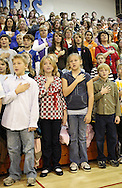 Strawberry Hill Elementary School Student Council members, Cole Sanders, 9, Danielle Davis-Wood, 11, Alexis Bowers, 11, and Kyle Schepanski, 10, (from left) lead the Pledge of Allegiance for the 14th Annual Veterans Day Assembly at Anamosa High School in Anamosa on Tuesday, November 11, 2008.  (Stephen Mally/Freelance)