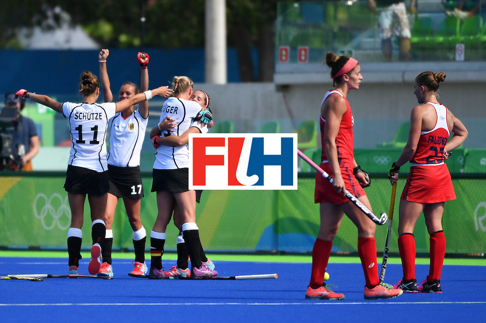Germany's players celebrate at the end of the the women's quarterfinal field hockey USA vs Germany match of the Rio 2016 Olympics Games at the Olympic Hockey Centre in Rio de Janeiro on August 15, 2016. / AFP / Pascal GUYOT        (Photo credit should read PASCAL GUYOT/AFP/Getty Images)