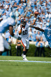 Virginia quarterback Jameel Sewell (10) passes against UNC.  The North Carolina Tar Heels football team faced the Virginia Cavaliers at Kenan Memorial Stadium in Chapel Hill, NC on September 15, 2007.  UVA defeated UNC 22-20.