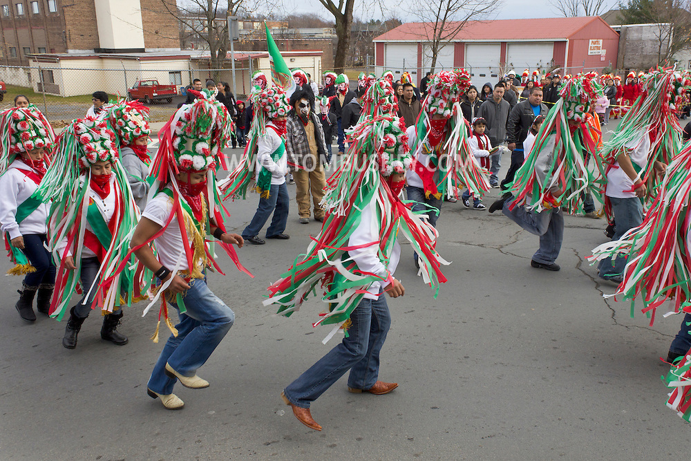 Middletown, New York - Members of St. Joseph's Church wearing traditional costumes dance while marching through the city during the festival of Nuestra Senora de Guadalupe on Sunday, Dec. 9, 2012.