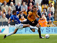 Photo: Richard Lane.<br /> Wolves v Leicester City. Coca Cola Championship.<br /> 17/09/2005.<br /> Wolves Lee Naylor is tackled by Patrick Kisnorbo.