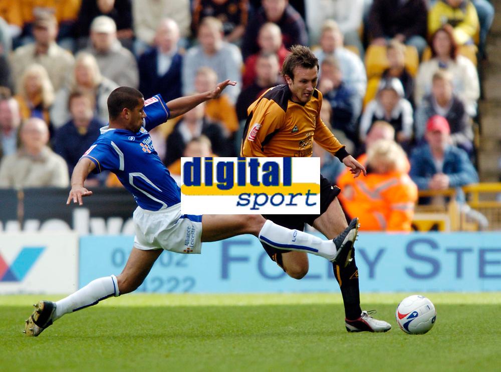 Photo: Richard Lane.<br /> Wolves v Leicester City. Coca Cola Championship.<br /> 17/09/2005.<br /> Wolves Lee Naylor is tackled by Patrick Kisnorbo.