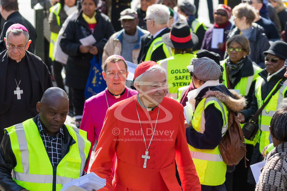 Westminster, London, March 25th 2016. Westminster's annual interdenominational Easter procession takes place with a procession from Methodist Central Hall to Westminster Cathedral and then on to Westminster Abbey, with the cross borne by people from The Passage, a homeless charity. PICTURED:  The Archbishop of Westminster Cardinal Vincent Nichols arrives at the Methodist Central Hall. <br /> ©Paul Davey<br /> FOR LICENCING CONTACT: Paul Davey +44 (0) 7966 016 296 paul@pauldaveycreative.co.uk
