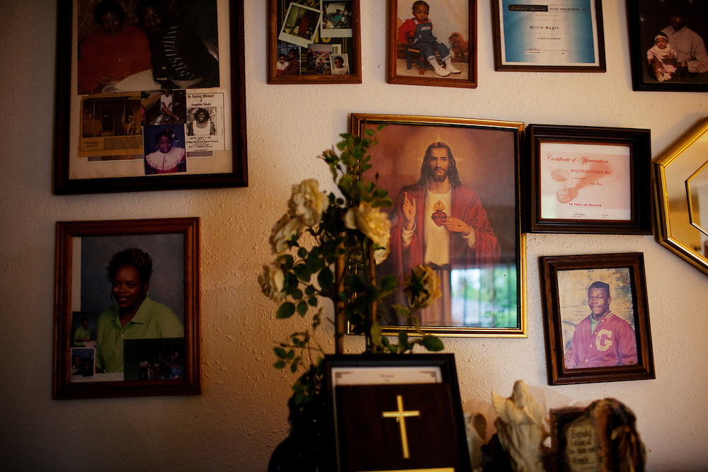 Pictures of family and faith decorate the walls in a home in the Baptist Town neighborhood of Greenwood, Mississippi on Thursday, May 20, 2010.