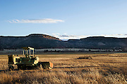 Old John Deere swather sitting idle on a pasture in far northeastern New Mexico