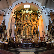The massive gold altar of Iglesia San Jose. It survived the pirate Henry Morgan's sacking of Panama Viejo in 1671 when a priest is reputed to have painted it black and convinced Morgan that it had already been stolen. The altar was later moved to its present location in Iglesia San Jose. The altar itself is carved mahagony that is painted with gold. Iglesia San Jose is in the heart of the historic Casco Viejo district of Panama City and dates to 1673.