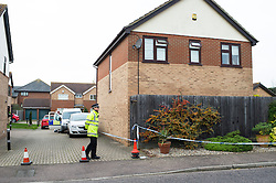 © Licensed to London News Pictures. 04/11/2013. Essex, UK. Detectives from Kent and Essex Serious Crime Directorate investigating a double shooting at Hemley Road, Orsett. About 3pm on Tuesday 2nd December police were called to the address near Grays. One man believed to be in his early 60's was declared dead at the scene and another man thought to be in his 40's was conveyed to a London hospital with gunshot wounds. A firearm was recovered from the scene. The younger male remains in hospital in a critical but stable condition. Police believe the men were known to each other and they are not looking for anyone elese in relation to this incident. Photo credit : Simon Ford/LNP