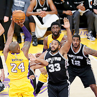 19 February 2016: Los Angeles Lakers forward Kobe Bryant (24) takes a jump shot over San Antonio Spurs center Boris Diaw (33) while Los Angeles Lakers center Roy Hibbert (17) and San Antonio Spurs forward LaMarcus Aldridge (12) vie for the  rebound during the San Antonio Spurs 119-113 victory over the Los Angeles Lakers, at the Staples Center, Los Angeles, California, USA.