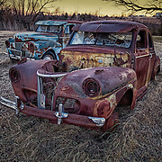 1949 Fords rust away in a field near Kingston, Ok.