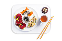 Red and golden beets, carrot, daikon, carrots and seaweed salad, tempeh with chives and sesame dipping sauce, black and white beans, green tea. Photograph by Jonathan Gayman, food styling by Carrie Province.