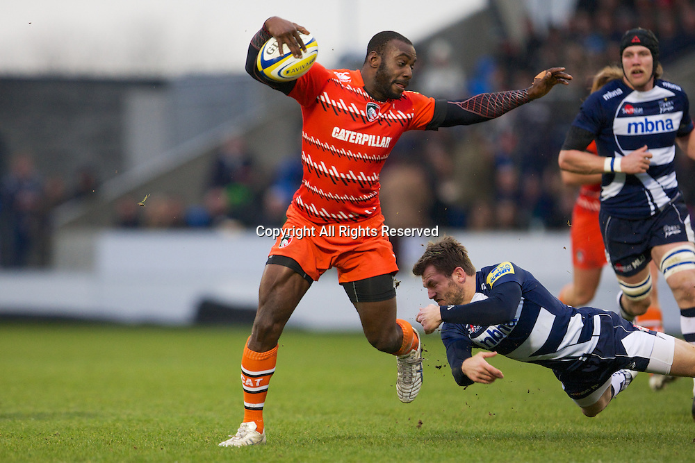 27.12.2014.  Sale, England.  Aviva Premiership. Sale Sharks versus Leicester Tigers. Leicester Tigers wing Miles Benjamin avoids being tackled by Sale Sharks wing Mark Cueto.