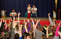 "Ryan Vezina with Blake and Justin Spencer of Recycled Percussion announce the start of the ""Kindness Club"" at Pleasant Street School during their surprise visit on Friday afternoon.   (Karen Bobotas/for the Laconia Daily Sun)"