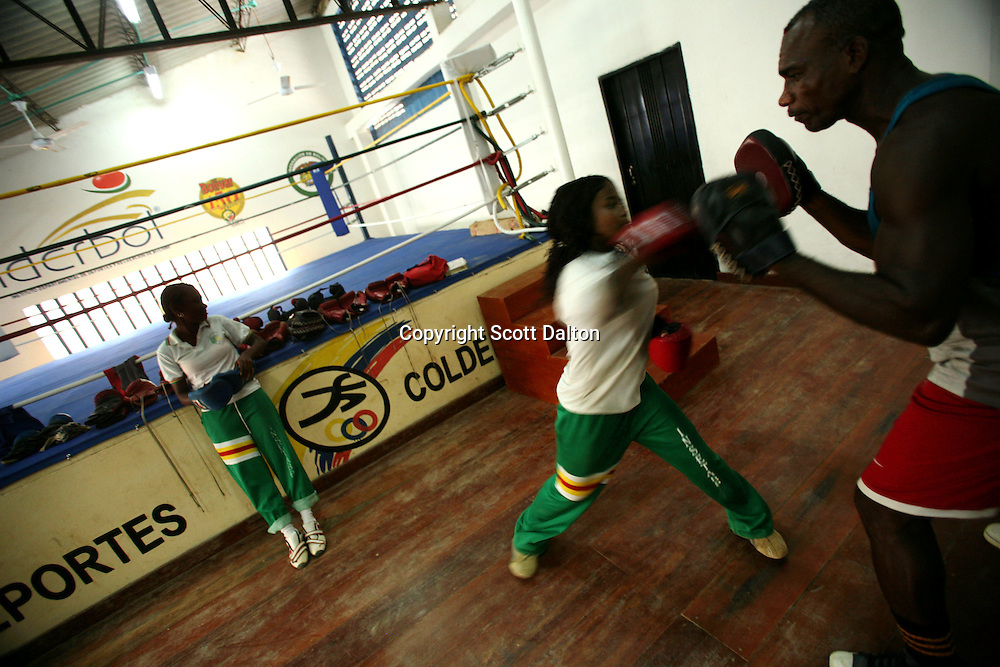 A young girl gets a boxing lesson at her school in San Basilio de Palenque, in northern Colombia, about 50 kilometers outside of Cartagena, on Tuesday, October 9, 2007. Runaway slaves founded the town of San Basilio de Palenque at the beginning of the 17th century. There are now efforts underway in the town to maintain the use of their unique language known as Palenquero, a Spanish-based creole language whose unique grammar and African influences have astonished linguists. (Photo/Scott Dalton).