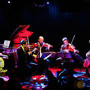 January 8, 2012 - Manhattan, NY : Andrew W.K. (piano and vocals), far left, and The Calder Quartet perform at Le Poisson Rouge in Manhattan on Sunday evening. The quartet is comprised of,  from second to left, Benjamin Jacobson (violin), Andrew Bulbrook (violin), Jonathan Moerschel (viola), and Eric Byers (cello).   CREDIT: Karsten Moran for The New York Times