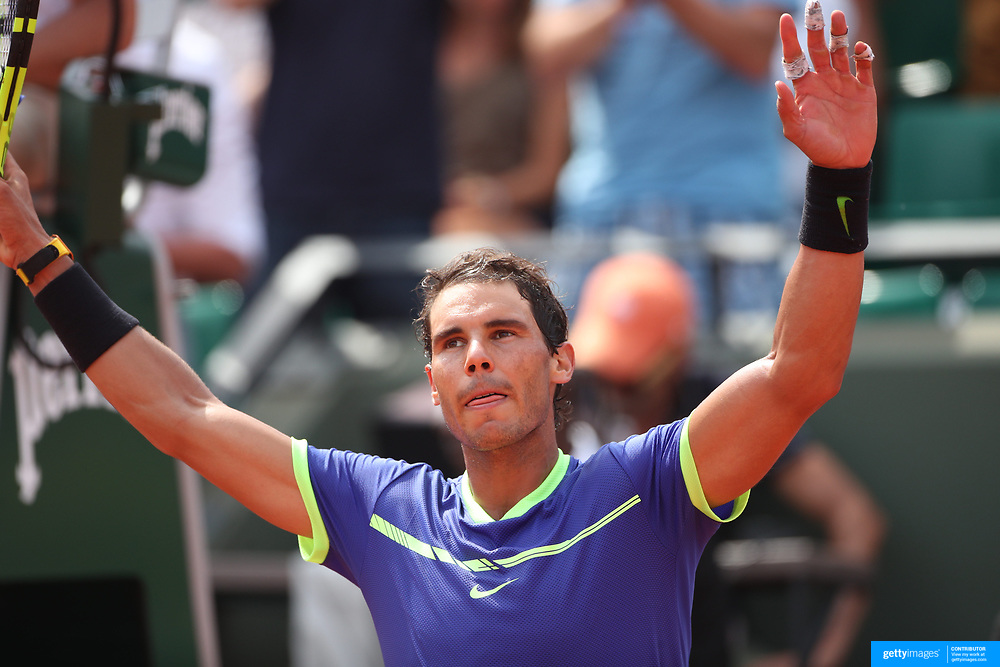 2017 French Open Tennis Tournament - Day Two.  Rafael Nadal of Spain celebrates his victory against Benoit Paire of France on Court Suzanne-Lenglen during the Men's Singles Round one match at the 2017 French Open Tennis Tournament at Roland Garros on May 29th, 2017 in Paris, France.  (Photo by Tim Clayton/Corbis via Getty Images)