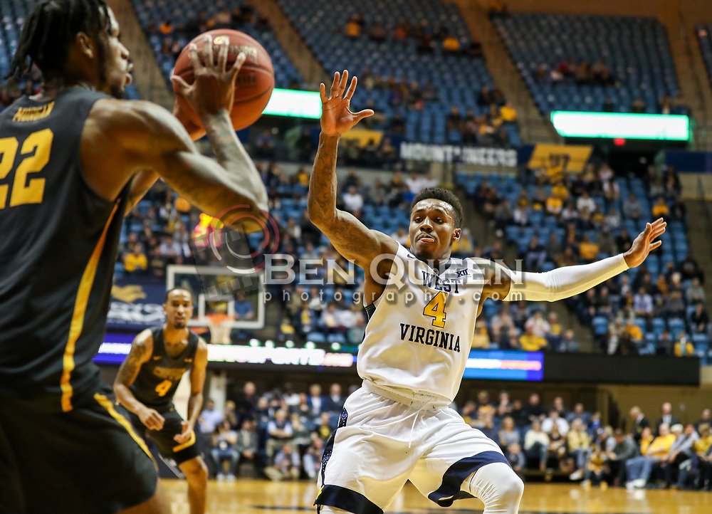 Dec 20, 2017; Morgantown, WV, USA; West Virginia Mountaineers guard Daxter Miles Jr. (4) defends Coppin State Eagles guard Lamar Morgan (22) during the first quarter at WVU Coliseum. Mandatory Credit: Ben Queen-USA TODAY Sports