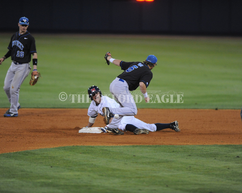 Ole MIss' Cameron Dishon (14) is safe at second vs. Kentucky's Matt Rieda (6) at Oxford-University Stadium in Oxford, Miss. on Thursday, April 25, 2013. Kentucky won 3-2.