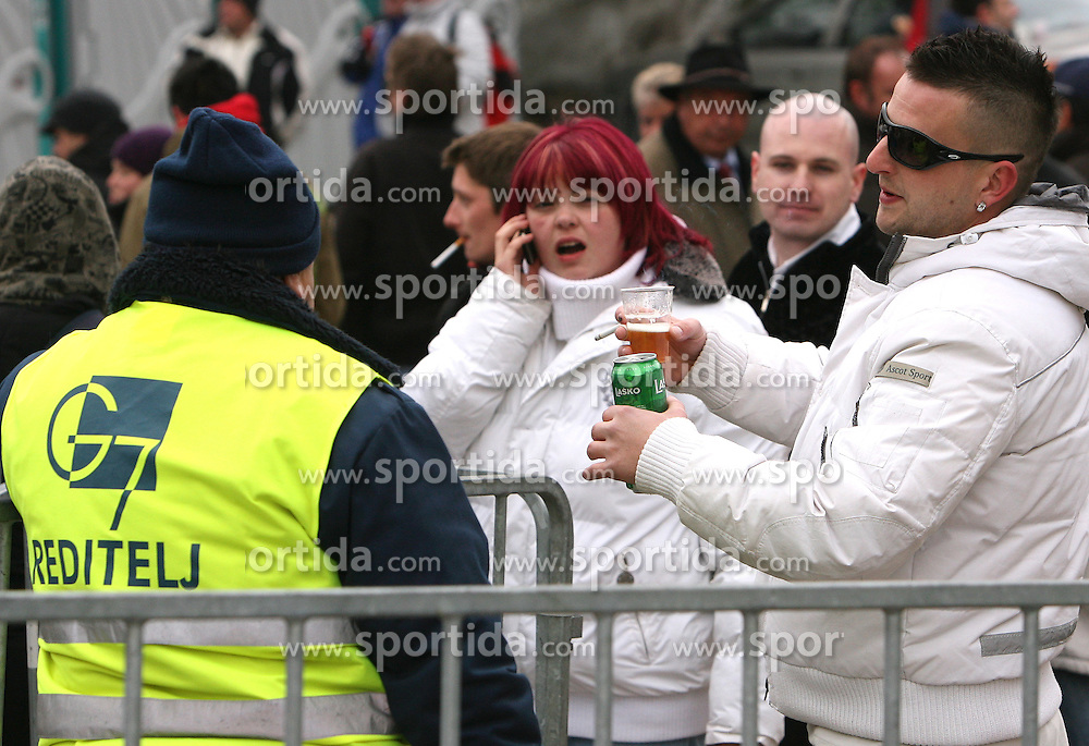Alcohol drink and security man at Flying Hill Team in 3rd day of 32nd World Cup Competition of FIS World Cup Ski Jumping Final in Planica, Slovenia, on March 21, 2009. (Photo by Vid Ponikvar / Sportida)
