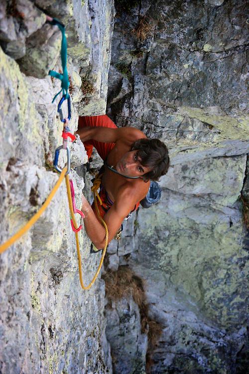 Nuno Soares climbing a trad route in Penacova, Portugal.