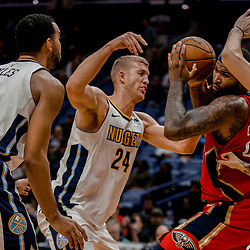 Dec 6, 2017; New Orleans, LA, USA; New Orleans Pelicans center DeMarcus Cousins (0) is triple teamed by Denver Nuggets center Mason Plumlee (24) and forward Trey Lyles (7) and forward Juan Hernangomez (41)  during the second half at the Smoothie King Center. The Pelicans defeated the Nuggets 123-114. Mandatory Credit: Derick E. Hingle-USA TODAY Sports
