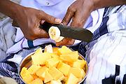 vendor preparing fruit salad, kerala, india