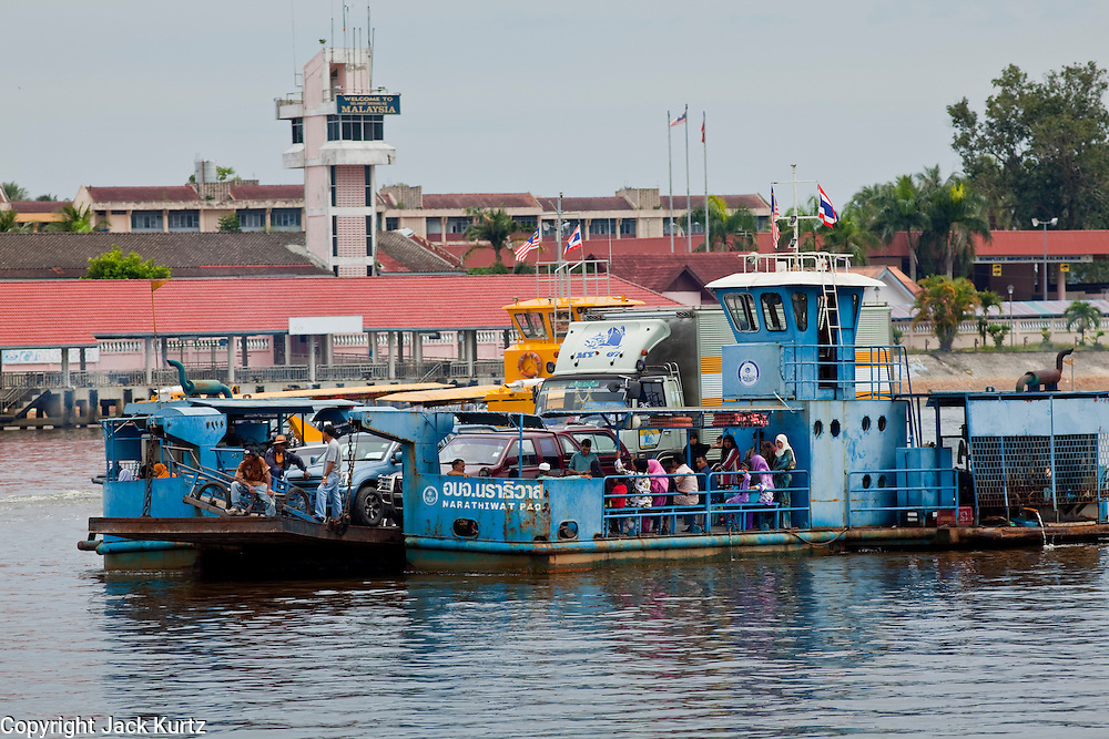 Sept. 27, 2009 -- TAK BAI, THAILAND: A ferry comes to Thailand from Malaysia in Tak Bai, Narathiwat, Thailand. The Thai-Malaysia border in Narathiwat province sees a steady stream of cross border trade but tourism from Malaysia which once flourished for Malaysians who wanted to drink and enjoy other vices prohibited in Muslim Malaysia has all but stopped since violence by Muslim insurgents in south Thailand destroyed several tourist hotels. Photo by Jack Kurtz / ZUMA Press