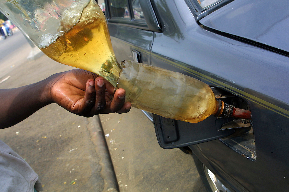 Benin november 28, 2001 - A petrol station in Cotonou, this petrol and diesel are smuggled from Nigeria. Nigerian oil compagnies are incapable of halting these parallel imports of petroleum. For many peoples, It's just a job and to try to survive