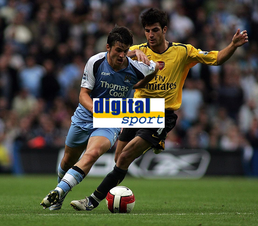 Photo: Paul Thomas.<br /> Manchester City v Arsenal. The Barclays Premiership. 26/08/2006.<br /> <br /> Man City goal scorer Joey Barton (L) gets past Cese Fabregas.