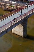 A man watches a duck - Pont de Sant Agustí, Girona, Catalonia, Spain