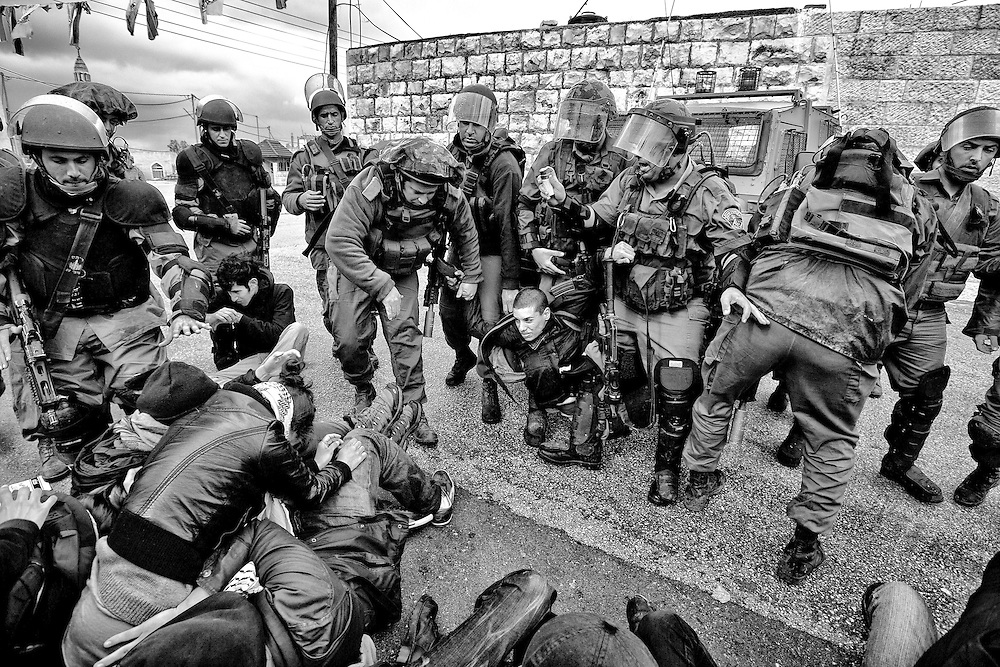 A group of international activists are arrested, triggering mayhem in the village of Nabi Saleh. During the melee, Israeli forces used tear gas, concussion grenades and pepper spray to regain control. Mar. 25, 2011. West Bank, Palestine.