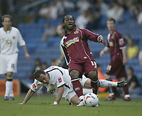 Photo: Aidan Ellis.<br /> Leeds United v Burnley. Coca Cola Championship. 14/04/2007.<br /> Leeds Radostin Kishishev challenges Burnley's Eric Djemba-Djemba