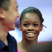 Gabrielle Douglas, USA, shares a joke with the USA coaches during the Women's Artistic Gymnastics podium training at North Greenwich Arena during the London 2012 Olympic games preparation at the London Olympics. London, UK. 26th July 2012. Photo Tim Clayton