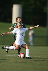 Virginia Cavaliers M Jen Redmond (4)..The Virginia Cavaliers Women's Soccer Team defeated the University of Vermont 6-0 on September 15, 2006 at Klöckner Stadium in Charlottesville, VA...