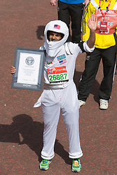 © Licensed to London News Pictures. 21/04/2013. London, England. Picture: Runner dressed as an Astronaut attempting a Guinness World Record. Celebrity Runners and Fun Runners finish the Virgin London Marathon 2013 race in the Mall, London. Many wore black ribbons to pay their respect for those who died or were injured in the Boston Marathon. Photo credit: Bettina Strenske/LNP
