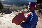 15 July 2011. White Hill, Tebellong hospital, Qacha's Nek, Lesotho. Winnowing of sorghum, separating the chaff from the grain.