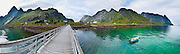 Ferry dock and steep mountains at Vindstad on Moskenesøya (Moskenes Island) on Reinefjord in the Lofoten archipelago, Nordland county, Norway, Europe. Panorama stitched from 5 overlapping photos.