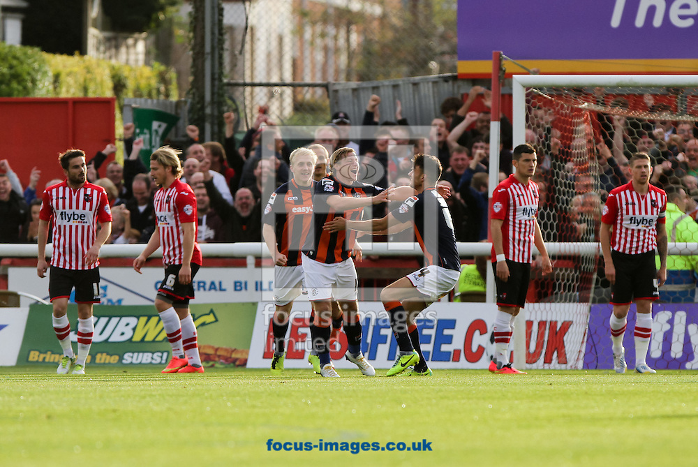 Scott Griffiths (centre) of Luton Town celebrates scoring his sides first goal with his team mates during the Sky Bet League 2 match at St James' Park, Exeter<br /> Picture by Tom Smith/Focus Images Ltd 07545141164<br /> 01/11/2014